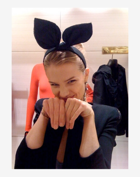 Rosie Huntington-Whiteley posing in a Louis Vuitton headband